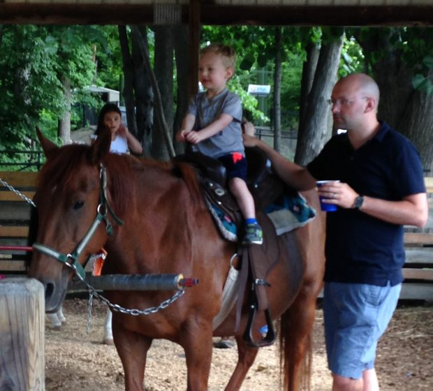 Let's look at something pretty before we go down this dark path, huh? Yeah, this will do. Jackson riding a horse at the Zoo while hubby Jake ponders what's going through the horse's head at current.